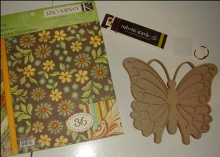 1 raw chipboard book, paper collection, rub-ons and1 ring web
