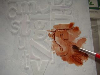 Watercolour paint onto dry gesso background