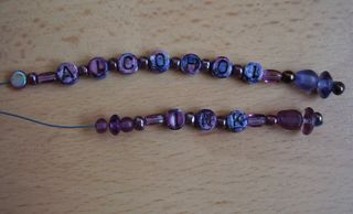 Inked beads on a wire web