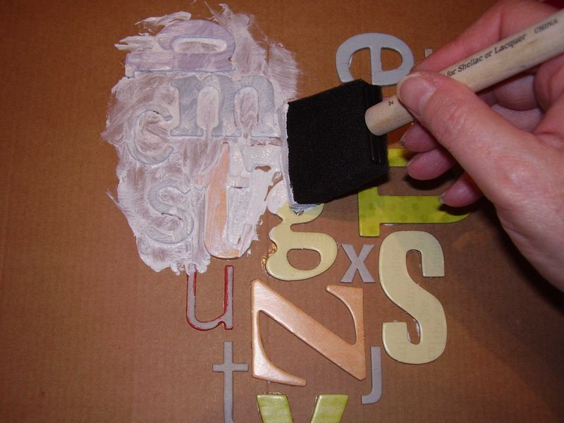 Gesso with sponge over letters web