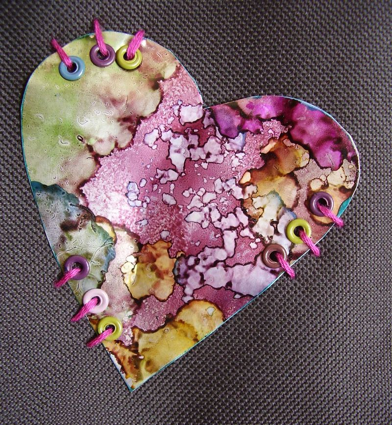 Stitched metal heart with eyelets web