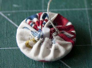 Gather stitches around button