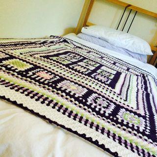 Purple blanket on bed
